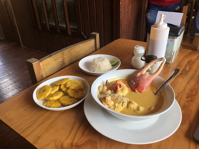 Seafood soup with tostones and rice