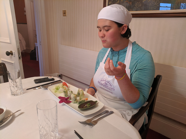 Opal savouring food she has prepared at the Thai cooking school