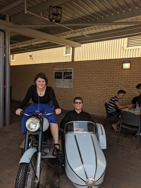 Opal riding the Harry Potter motorbike and Paul sitting in the sidecar
