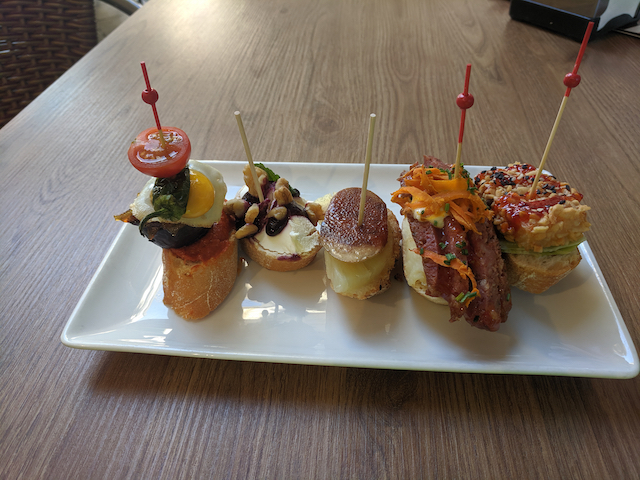 5 portions of tapas on a plate