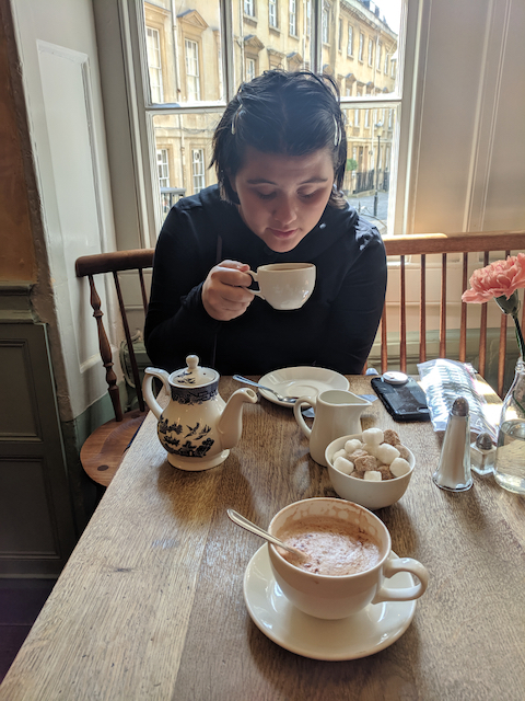 Opal drinking tea at Sally Lunn in Bath